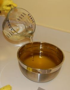 Pouring lye into oils for soap making