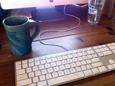 6:05 am My writing station, complete with green mug