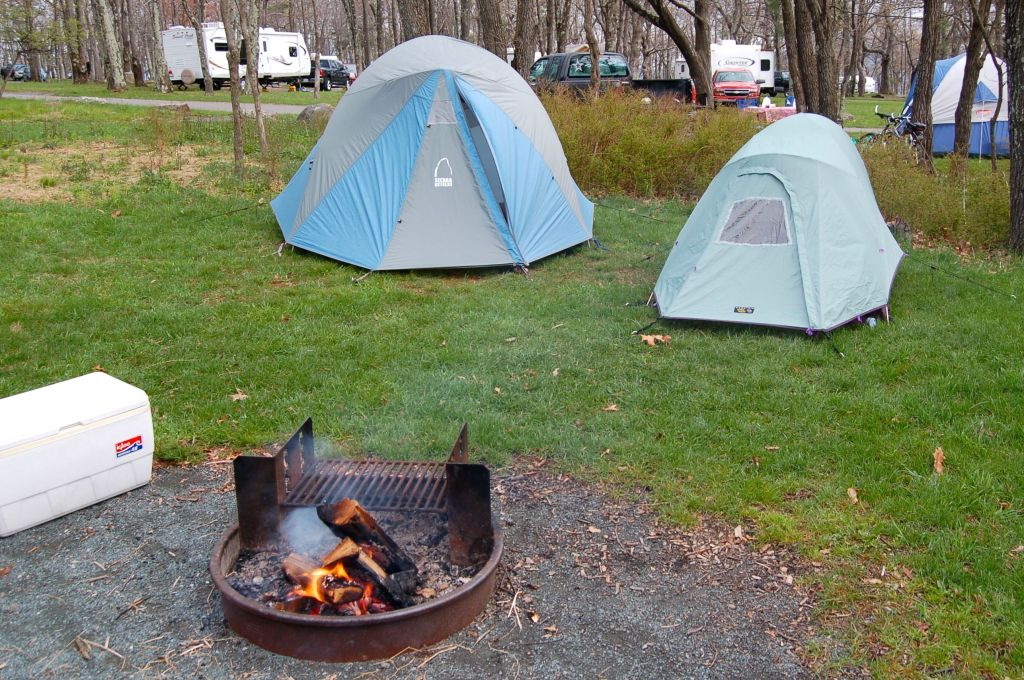 Camping tents with cooler and campfire on andreabadgley.com