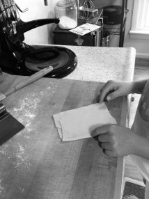 Folding pasta dough to roll it black and white photograph on andreabadgley.com