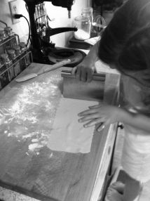 Cutting pasta dough into manageable sheets b&w photo on andreabadgley.com