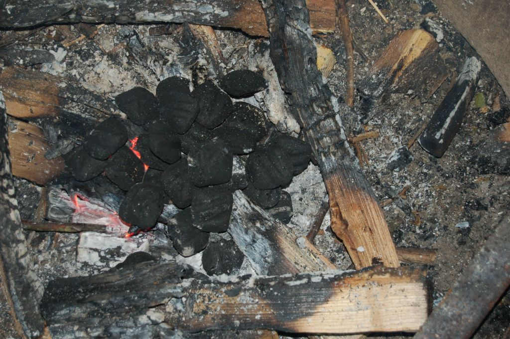 Pile of charcoal briquettes on campfire for Dutch oven crisp on andreabadgley.com