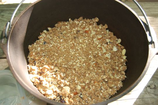 Assembled blueberry crisp in cast iron Dutch oven for campfire dessert on andreabadgley.com