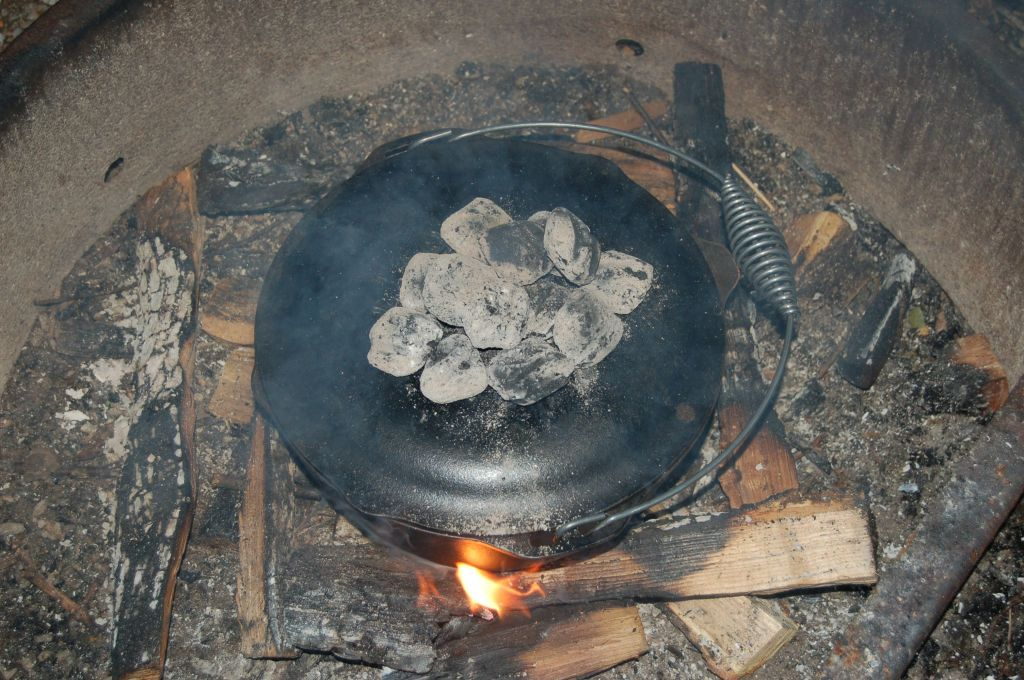 Cast iron Dutch oven with campfire coals on andreabadgley.com
