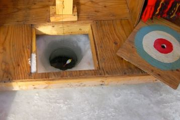 Ice fishing hole, Art Shanty, Minnesota, 2010