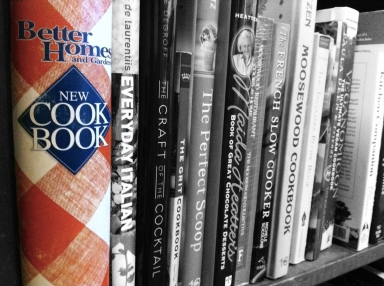Red and white checked cookbook on shelf black and white selectively colorized photograph on andreabadgley.com