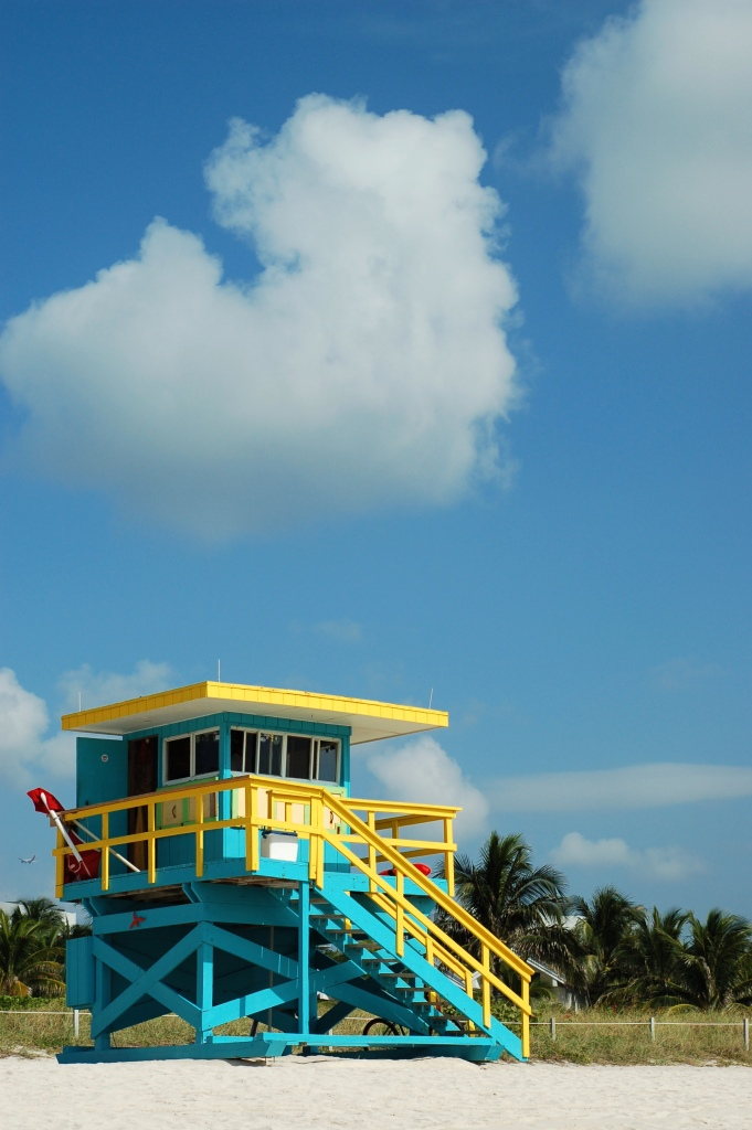 Blue and yellow lifeguard stand with clouds by Andrea Badgley on Butterfly Mind