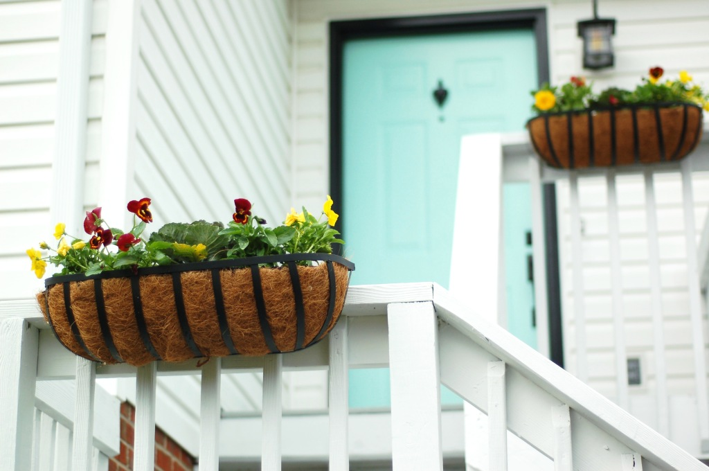 window boxes on porch rail