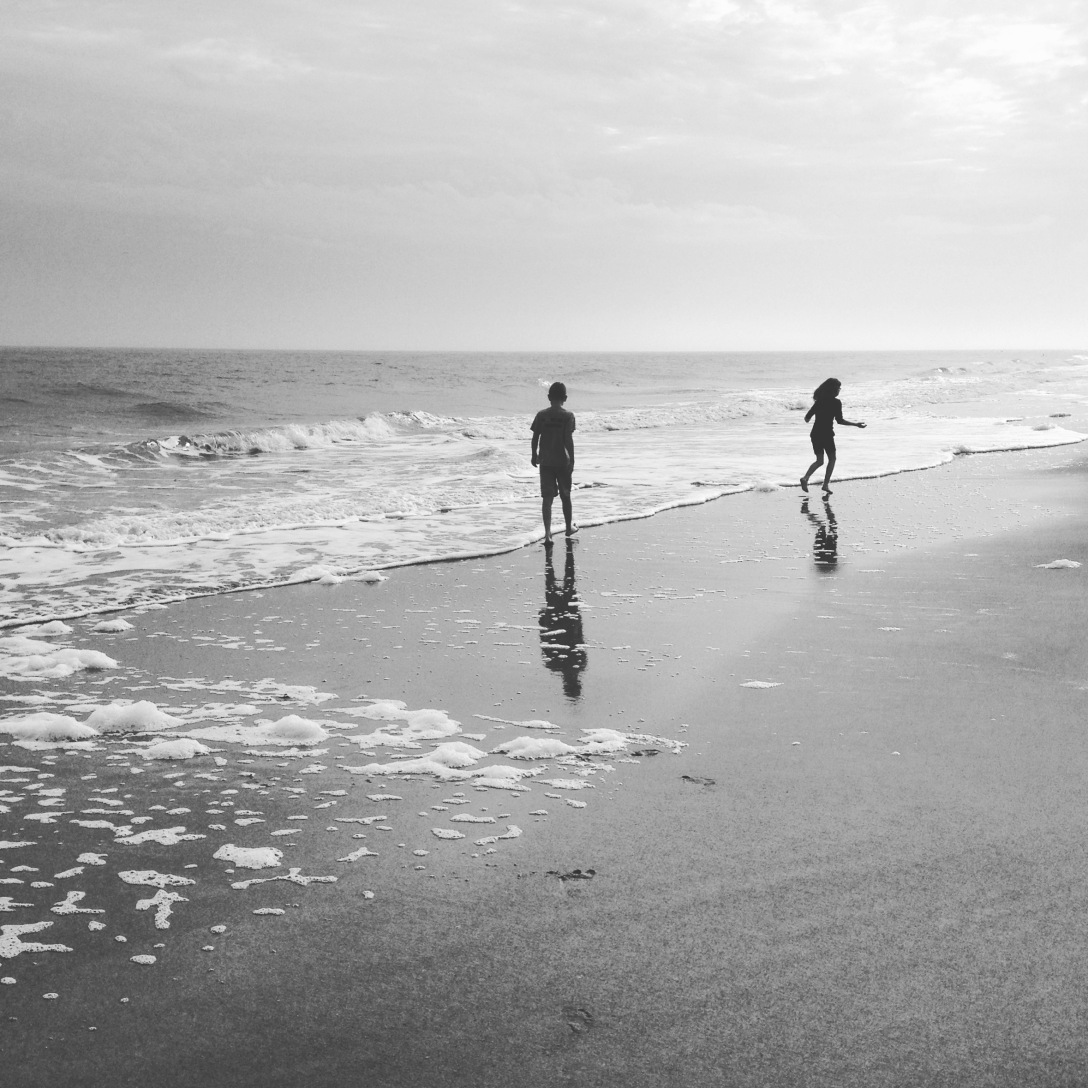 Black and white photo of kids at beach
