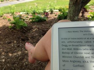 Reading under the dogwood