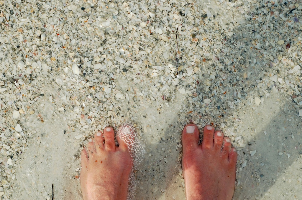 feet in sand and bubbles