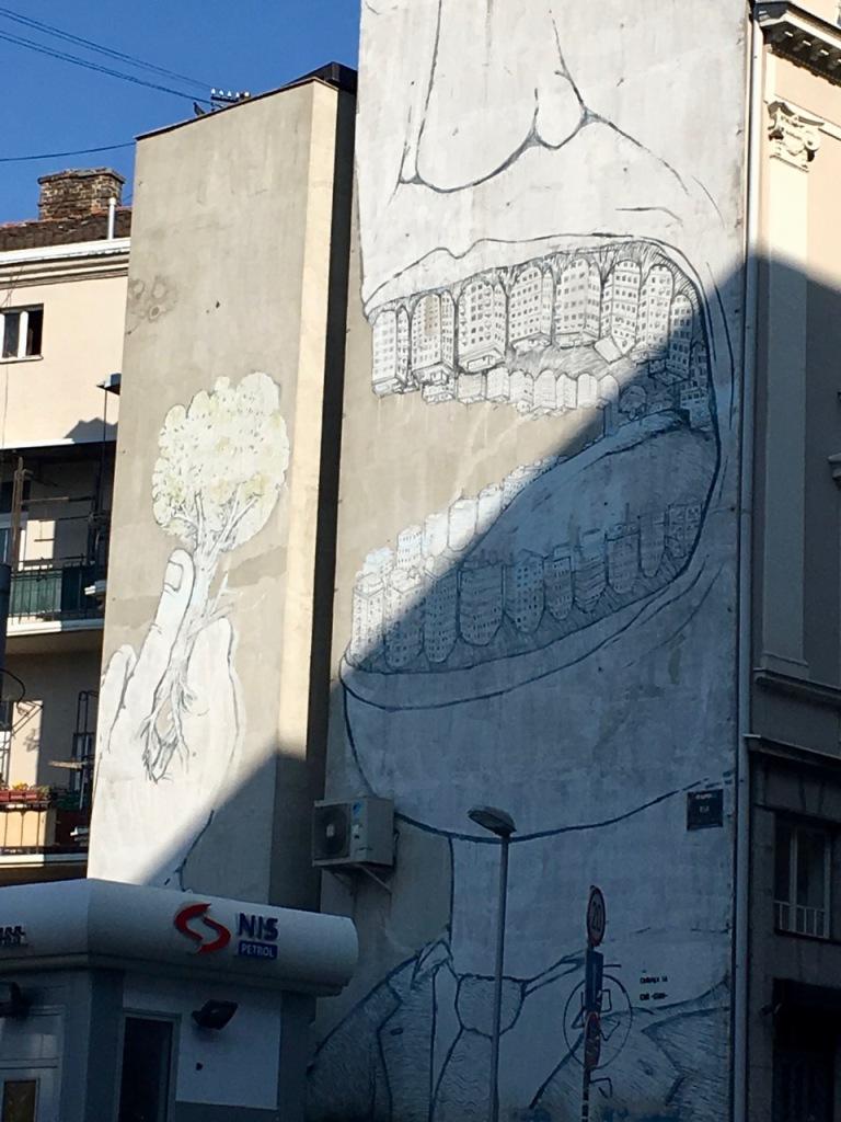 city eating nature street art